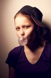 Teen girl blowing bubble Royalty Free Stock Image