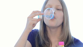 Teen girl blowing bubbles stock footage