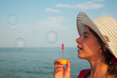 Teen girl blowing bubbles Stock Images