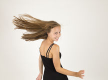 Teen girl with blowing hair Stock Photo
