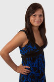Teen girl in blue dress. Attractive brunette aboriginal teen smiling showing dimple with long hair wearing blue dress standing over white royalty free stock photos