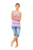 Teen girl with blue jeans and tank top Royalty Free Stock Images