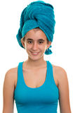 Teen girl with a blue towel wrapped over her wet hair Royalty Free Stock Photography