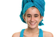 Teen girl with a blue towel wrapped over her wet hair Stock Photo