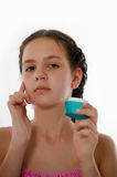 Teen girl with body lotion Royalty Free Stock Photo