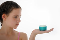 Teen girl with body lotion Stock Images
