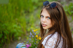 Teen Girl boho with bouquet of wildflowers. Stock Images