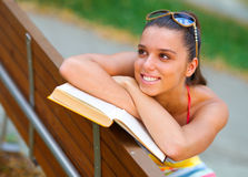 Teen girl with book Stock Images
