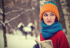 Teen girl with a book Royalty Free Stock Photos