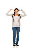Teen girl with book over her head. Royalty Free Stock Image