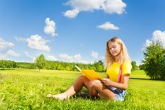 Teen girl with book in the park Stock Photo