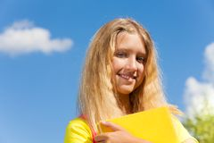 Teen girl and book portrait Royalty Free Stock Image