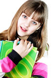 Teen girl with books. Teen funny smiling girl with books over the white Stock Image