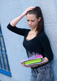 Teen girl with books. Sad teen girl with school books Royalty Free Stock Image