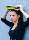 Teen girl with books. Sad teen girl with school books on top of her head Royalty Free Stock Image