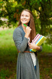 Teen girl with books in hands Royalty Free Stock Images