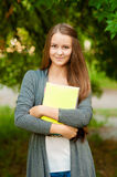 Teen girl with books in hands Royalty Free Stock Photo