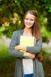 Teen girl with books in hands Royalty Free Stock Photos