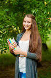 Teen girl with books in hands Stock Photos