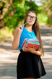 Teen girl with books in hands Stock Images