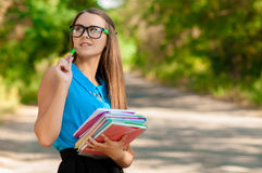 Teen girl with books in hands Royalty Free Stock Photography
