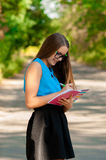 Teen girl with books in hands Stock Photo