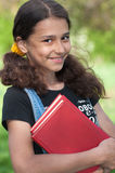 Teen girl with books. On nature Royalty Free Stock Image