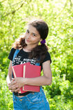 Teen girl with books on nature. Teen girl with books on the nature Stock Images