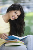 Teen girl with books Stock Photos