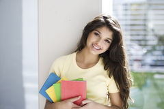 Teen girl with books Royalty Free Stock Photos