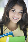 Teen girl with books Royalty Free Stock Images