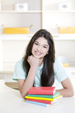 Teen girl with books Stock Images