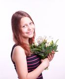 Teen girl with a bouquet of flowers Stock Image