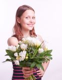 Teen girl with a bouquet of flowers Royalty Free Stock Image
