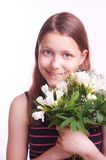 Teen girl with a bouquet of flowers Stock Photo