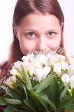 Teen girl with a bouquet of flowers Stock Photos
