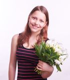 Teen girl with a bouquet of flowers Stock Images