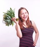 Teen girl with a bouquet of flowers Royalty Free Stock Photo