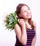 Teen girl with a bouquet of flowers Royalty Free Stock Photos
