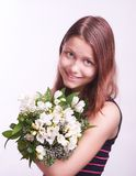 Teen girl with a bouquet of flowers Royalty Free Stock Images