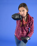 Teen girl with boxing glove. Teen girl looking at camera and boxing Royalty Free Stock Photo