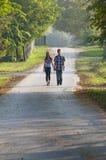 Teen girl and boy walking Royalty Free Stock Photography