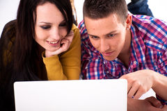 Teen girl and boy with white laptop Royalty Free Stock Photos