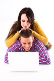 Teen girl and boy with white laptop Stock Photography