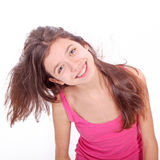 Teen girl with brackets. Beautiful young teen girl with brackets on teeth in white Stock Photo