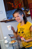 Teen girl at breakfast Royalty Free Stock Photography