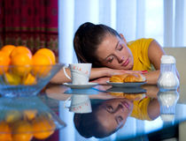 Teen girl at breakfast Stock Images