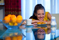 Teen girl at breakfast Stock Photos