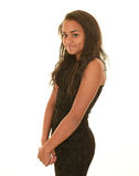 Teen girl in brown dress. Teen girl with long brunette hair posing in brown dress, smiling and looking at camera with hands crossed Stock Images