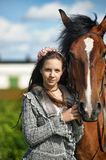 Teen girl with the brown horse Royalty Free Stock Photography
